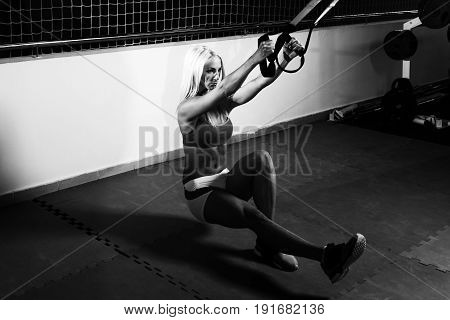 Attractive Woman Training With Trx Fitness Straps