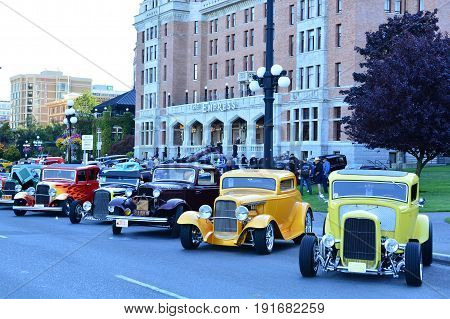 Victoria BC,Canada,July 24th 2015.Classic autos lined up in front the the Empress hotel in Victoria during Deuce Coupe car show.