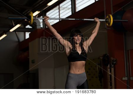 Shoulder Exercise With Barbell In Gym