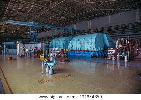 Turbo generator with hydrogen cooling at the machinery room of Nuclear Power Plant.