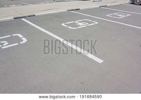 Disabled Parking Sign On Asphalt. Handicapped Sign Parking Spot.