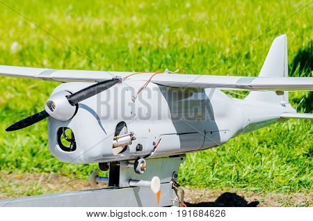 Unmanned aircraft with a propeller and wings