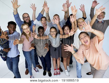 Diverse group of people smiling and arms raised