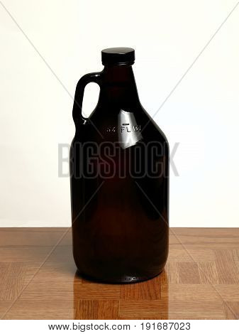 Homebrew Beer in Growler on Oak Table