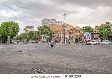 YAZD, IRAN - MAY 5, 2015: Traffic on the main intersection by the fountain in old city.