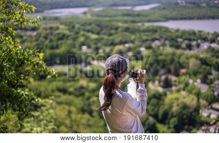 Cold Spring NY USA - May 28 2017. A woman is taking photos duing the hiking break