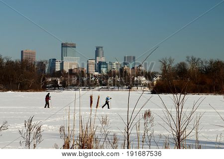 Skiing Under The Minneapolis Skyline On Lake Of The Isles