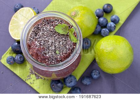 Healthy vegan chocolate chia pudding with blueberries.