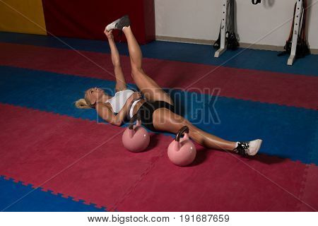 Fitness Woman Stretching With Kettle-bell