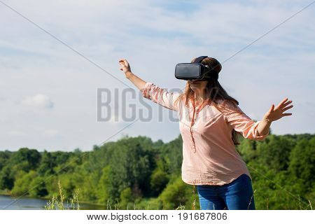 A woman watching a video in virtual reality glasses