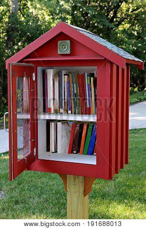 Books in Sidewalk Library in Residential Neighborhood