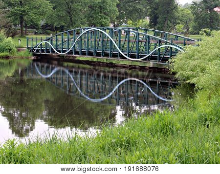 Footbridge Reflecting in Pond near Lake Calhoun