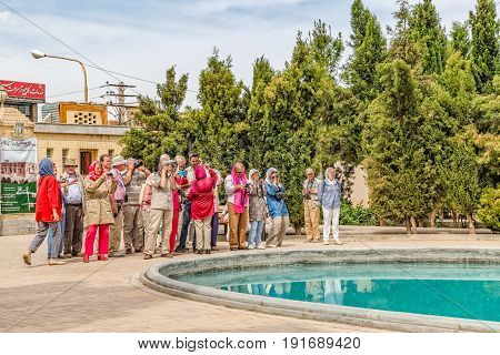 YAZD, IRAN - MAY 5, 2015: Group of tourists visiting the fire temple Atash Behram in old city.