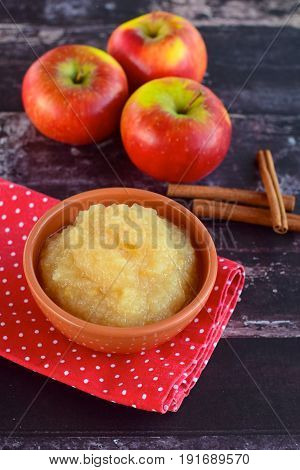 Homemade apple sauce with fresh red apples