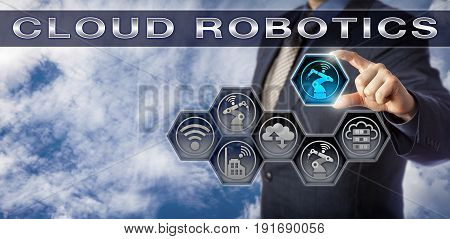 Blue chip industrial manager plugging virtual six axis robotic arm into a CLOUD ROBOTICS planning matrix. Industry and technology concept for robotics enabled via cloud computing and shared services.
