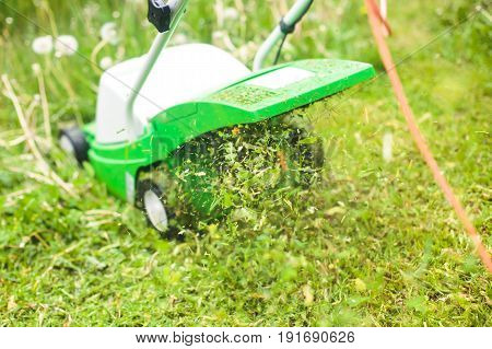 A Process Of Lawn Mowing, Concept Of Mowing The Lawn, Lawnmower Cutting Grass With Gardening Tools A