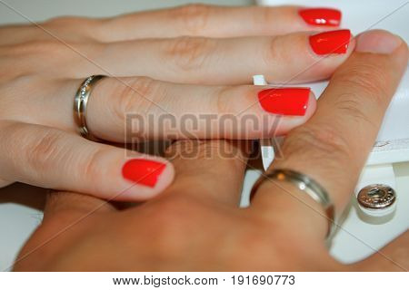 picture of man and woman with wedding rings