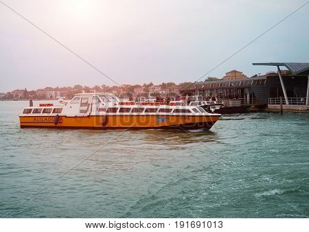VENICE, ITALY - APRIL 27, 2017: view of water buses with tourists  in the waters of Venice, Italy on April 27, 2017