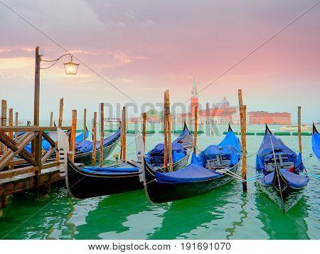 Venice with gondolas and Street light on Grand Canal against San Giorgio Maggiore church