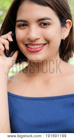 A Portrait of a Female Talking On Phone