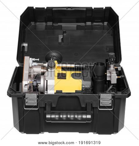 Yellow plunge router in toolbox, isolated on white background.