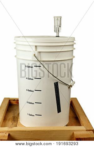 Homebrew Fermenting in a Bucket on a Wooden Cart