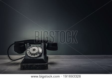 Retro phone on the table. Vertical. Copypast