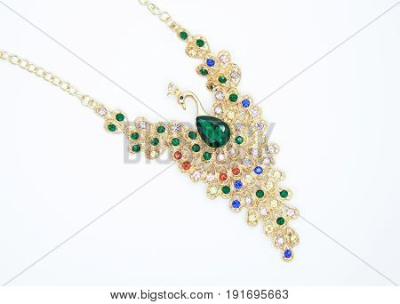 really precious necklace in the form of a bird with beautiful green and colourful stones the concept of fashion style
