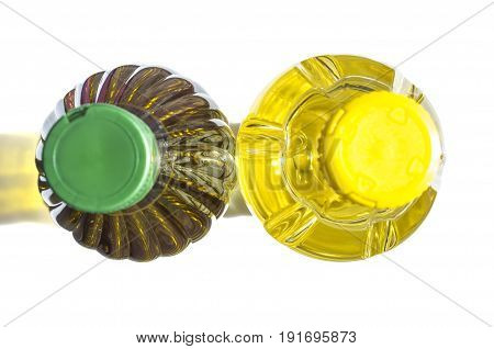 Olive versus sunflower oil bottled in PET. Upper view. Isolated over white