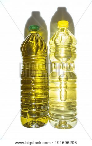 Olive versus sunflower oil bottled in PET. Isolated over white