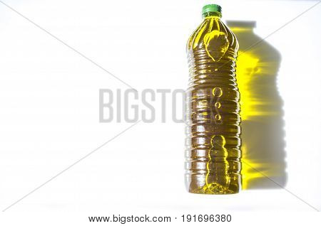 Olive oil bottled in PET with golden reflections. Isolated over white