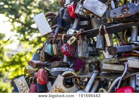 close-up of many different closed lovelocks at the bridge