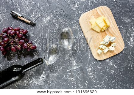 Bottle of red wine with cheese and grape aperitive on white background.