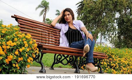Diverse Girl And Worry Sitting On Bench