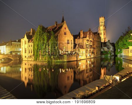 The dock of the Rosary, Rozenhoedkaai, with Belfry Tower by night, Bruges, Belgium.