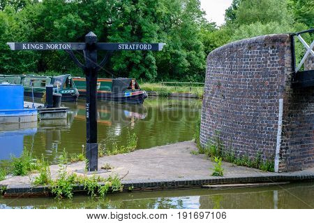 Birmingham Canal junction with direction sign to Kings Norton and Stratford