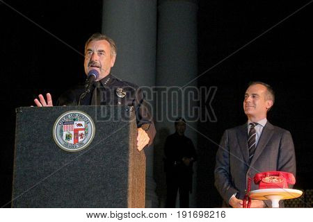 LOS ANGELES - JUN 15:  Charlie Beck, Eric Garcetti at the Bat Signal Lighting Ceremony to honor Adam West at the Los Angeles City Hall on June 15, 2017 in Los Angeles, CA