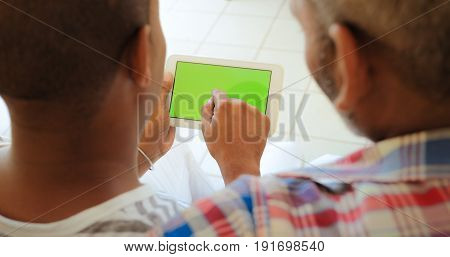 Green Screen Tablet Monitor With Homosexual Men Using Internet