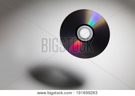 a CD DVD disk with dark shadow technology concept.