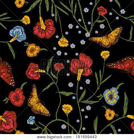Embroidery floral seamless pattern with poppies and butterflies. Vector traditional native bouquet. Tribal style design for fashion wearing.