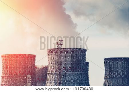 Cooling tower of nuclear power plant with sunlight effect, nuclear energy concept