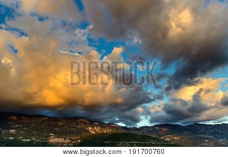 Panoramic landscape of sky and rocks near Budva riviera. Fantastic view of the overcast sky. Dramatic sunset scene. Balkans, Adriatic sea, Europe.