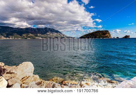 Panoramic landscape of Budva riviera in Montenegro. Fantastic view of the overcast sky. Balkans, Adriatic sea, Europe