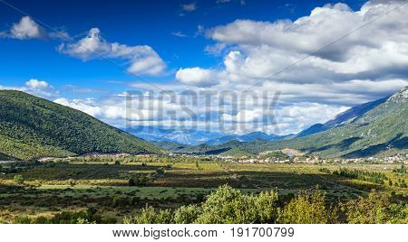 Montenegrin landscape. Blue sky and white clouds in the mountains