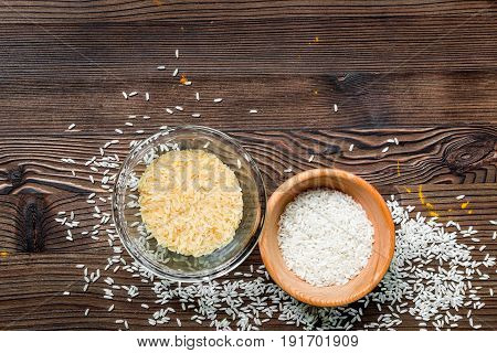 paella home cooking with rice for ingredients on wooden kitchen table background top view space for text