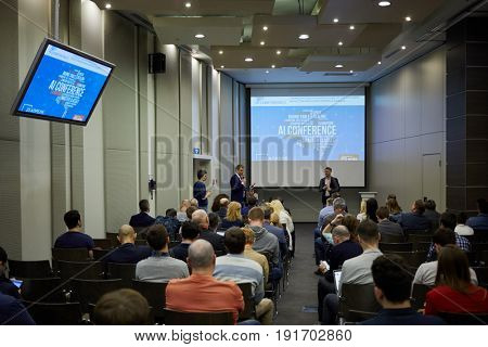 MOSCOW, RUSSIA - APR 25, 2017: People in auditorium during AI Conference in Novotel Moscow City Hotel. Conference is devoted to introduction of artificial intelligence in business.