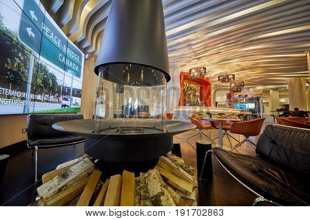 MOSCOW, RUSSIA - APR 25, 2017: Interior of MC Traders Lounge Bar in hall of Novotel Moscow City Hotel with fireplace and beer cellar.