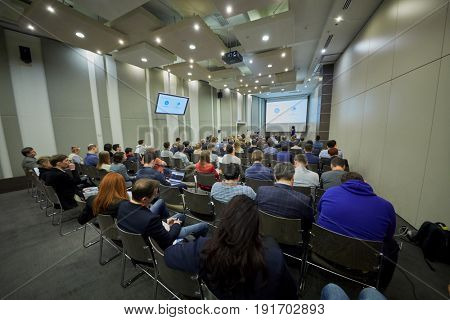 MOSCOW, RUSSIA - APR 25, 2017: Listeners in auditorium during AI Conference in Novotel Moscow City Hotel. Conference is devoted to introduction of artificial intelligence in business.