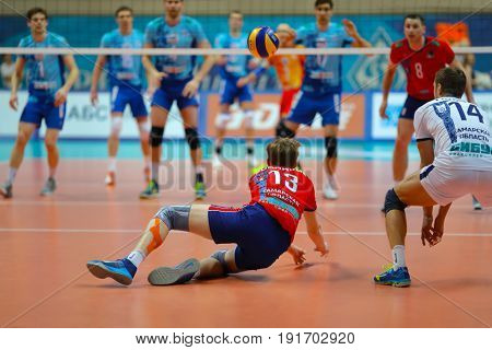 MOSCOW - APR 8, 2017: Player does dig during match of Russian Volleyball Championship Dynamo (Moscow) - Nova (Novokuibyshevsk) in Palace of Sports Dynamo