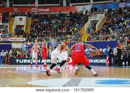 MOSCOW - APR 7, 2017: Two players with ball at basketball game Euroleague CSKA Moscow (Russia) - Olympiakos (Greece) in Megasport stadium